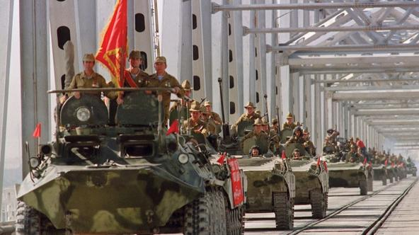 'TERMEZ, RUSSIA - MAY 21:  A convoy of Soviet Army armoured personal vehicles cross a bridge in Termez, 21 May 1988 at Soviet-Afghan border, during the withdrawal of the Red Army from Afghanistan. The